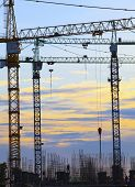 picture of land development  - crane of building construction against beautiful dusky sky use for construction industry business and land development - JPG