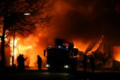 stock photo of fire brigade  - Firemen at work during a major fire at night - JPG