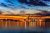 foto of shipbuilding  - Sunset over an industry harbor with cranes in Stavanger Norway - JPG