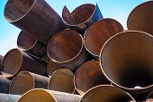 picture of orifice  - Lots of rusty metal pipes put together - JPG