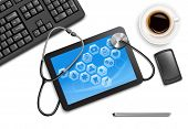 picture of stethoscope  - tablet screen with medical icons and stethoscope on the table at the doctor - JPG