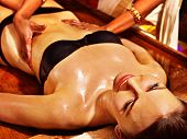 stock photo of ayurveda  - Young woman having stomach Ayurveda spa treatment - JPG