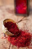 picture of saffron  - saffron spice in rustic sieve on old wooden background - JPG