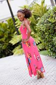 stock photo of jamaican  - Stock image of a young Jamaican model posing in a pink summer dress - JPG