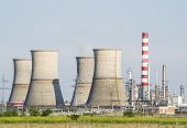 image of chimney  - Oil refinery landscape with tall industrial chimneys and petrochemical installations - JPG