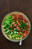 stock photo of kidney beans  - Fresh chopped greens cucumber tomato avocado and scallions with red kidney beans and flat leaf parsley and a lemon garlic dressing make a lovely summer salad - JPG