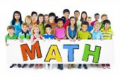 pic of math  - Diverse Cheerful Children Holding the Word Math - JPG