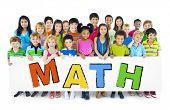 foto of math  - Diverse Cheerful Children Holding the Word Math - JPG