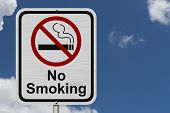 foto of traffic rules  - No Smoking Sign Red and White sign with words No Smoking and cigarette symbol with blue sky background - JPG