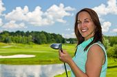 stock photo of ladies golf  - Woman at the golf course on a beautiful summer day - JPG
