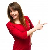 pic of human rights  - Portrait of a young woman pointing to the right using her index finger - JPG