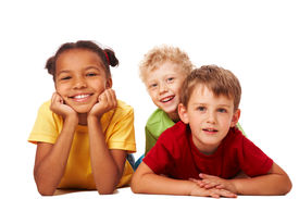 picture of children group  - Portrait of three children lying and looking at camera - JPG