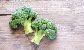 foto of cruciferous  - Broccoli Florets On The Wooden Table Close Up - JPG