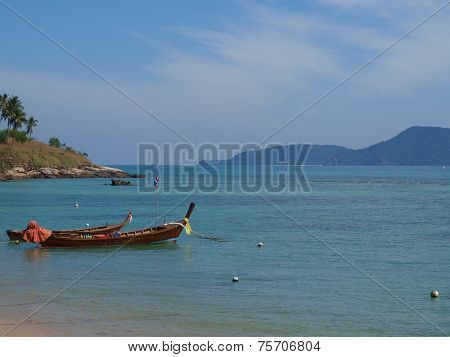 longtail boat in bay of Phuket island, Thailand.