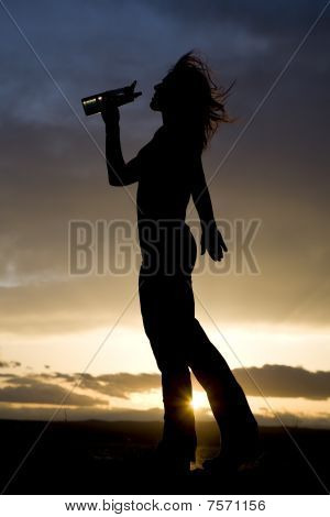 Woman And Water Bottle In Silhouette