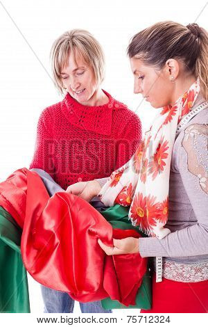 Dressmakers Choosing The Fabric