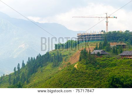 Construction Crane Building On Hilltop