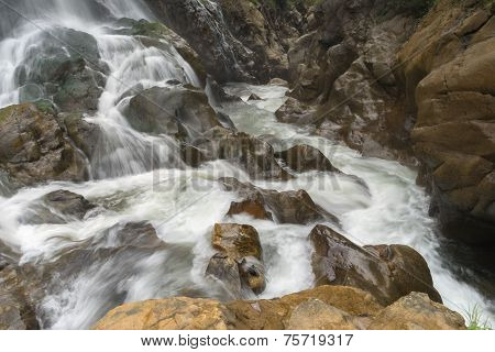 Waterfall Flows Down The Mountain