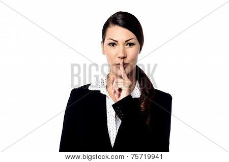 Pretty Woman With Finger On Lips