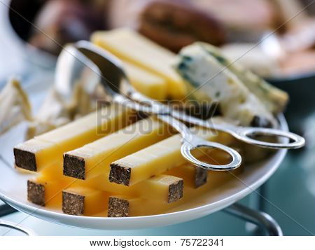 Sliced of cheese on a plate