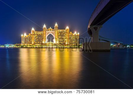 DUBAI, UAE - MARCH 31, 2014: Atlantis hotel iluminated at night in Dubai, United Arab Emirates. Atlantis the Palm is a luxury 5 star hotel built on an artificial island with over 1,500 guestrooms.