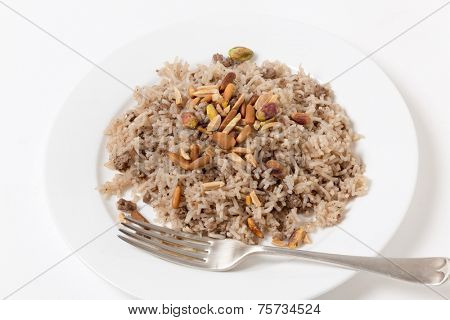 Lebanese spiced rice with minced beef and garnished with freshly toasted nuts