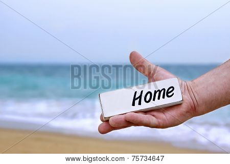 Male Hand With Home Signboard
