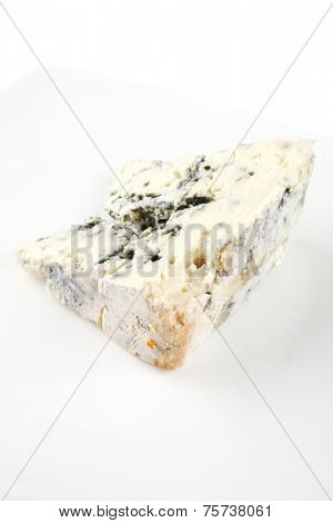 soft moldy gorgonzola cheese on white cheese