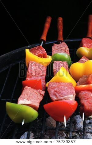 fresh raw beef shish kebab with pepper chunk on black big grill bbq high resolution hidef