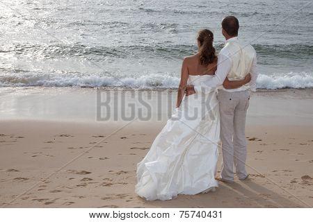 Cute Happy Couple On The Beach