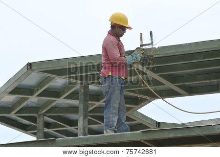 Construction welder welding metal