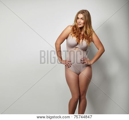 Chubby Young Woman In Body Stocking