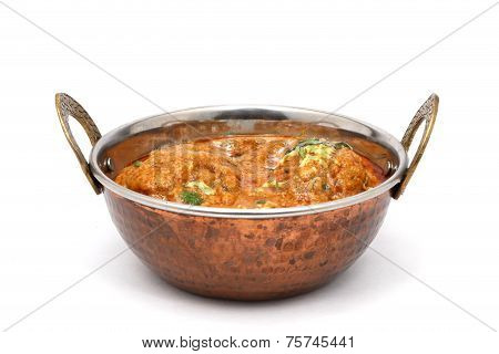indian food in brass bowl