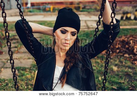 Portrait Of A Beautiful Girl Hipster On A Swing