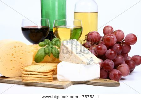 Various types of cheese and wine