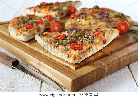 Four Pieces Of Tasty Pizza With Tomatoes, Pickles And Minced Meat