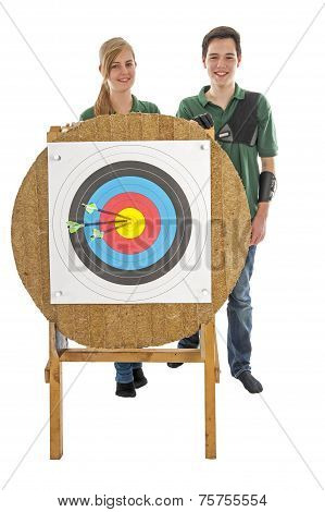 Girl And Boy Standing Behind Archery Target