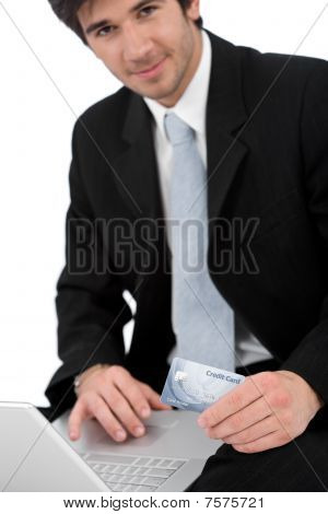 Young Businessman With Laptop Holding Credit Card