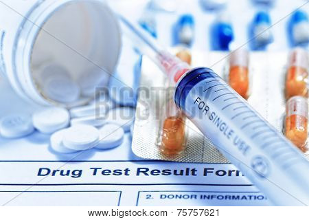 Syringe with glass vials and medications pills drug test report