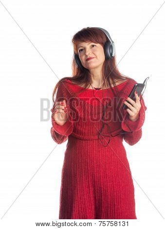 beautiful adult woman listening music, isolated