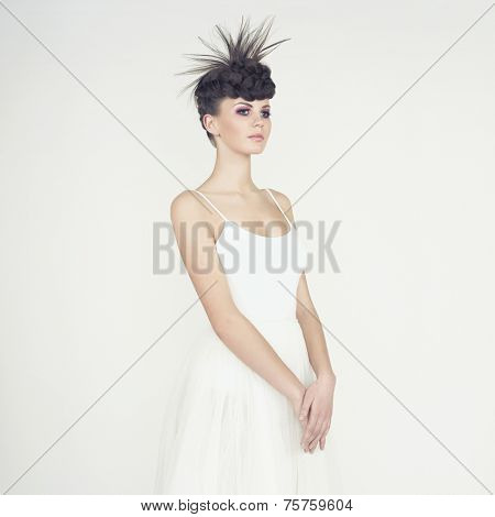 Portrait of beautiful elegant ballerina on white background