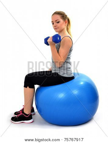 Girl working out with dumbbells isolated on a white background