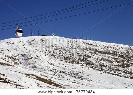 Gondola Lifts And Slope With Stones