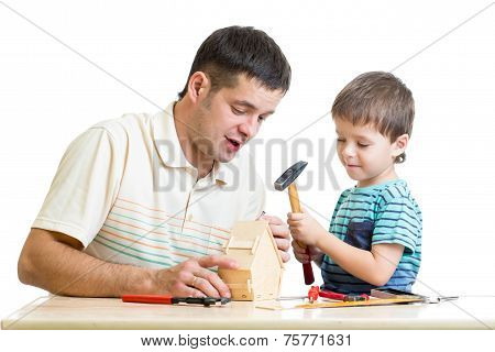 Dad and son kid tinkering nesting box