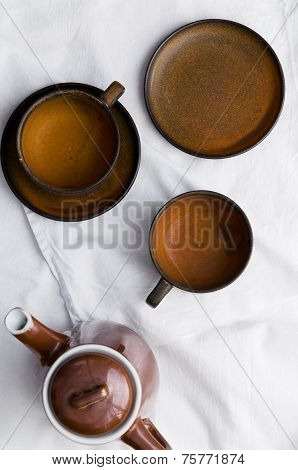 Teapot And Empty Brown Tea Cups