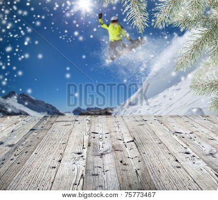 Winter background with wooden table. Ideal for your product placement.