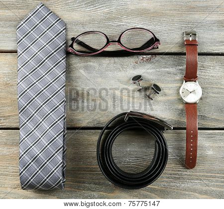 Essentials fashion man objects on wooden background
