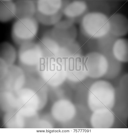 Black Defocused Bokeh Twinkling Lights Vintage Background. Festive Christmas Background. Abstract Tw