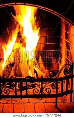 Burning Fireplace. Chimney And Woodpile. Chimney Place. Christmas Fireplace.