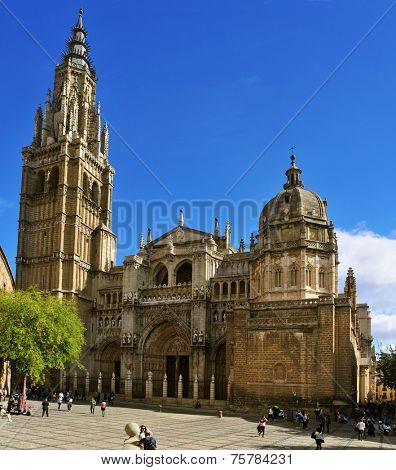 TOLEDO, SPAIN - OCTOBER 16: Tourists around the main facade of the Cathedral of Saint Mary of Toledo on October 16, 2014 in Toledo, Spain. It is one of the main landmarks in the Old Town of the city